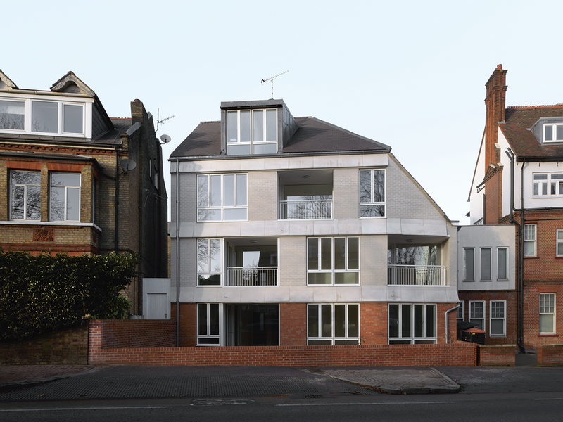 The building's rear elevation faces West Hill, also known as the A3. Its steeply pitched roof leans away from adjacent Suffolk Hall.