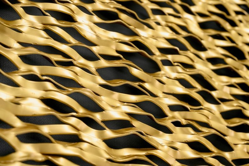 Stamisol Safe One breather membrane: Gold-anodised expanded metal with black facade membrane.