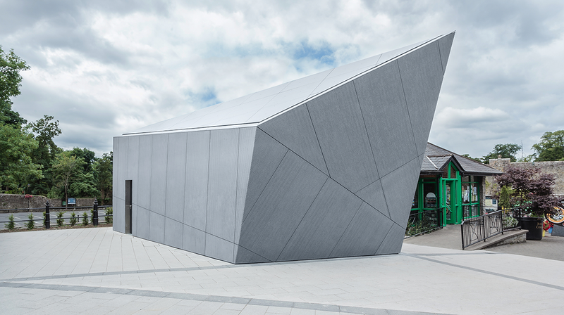 Cahir public toilets in Co Tipperary clad in Equitone Linea: Presenting the building as one single grey volume that reflects the colour and massing of the local limestone.