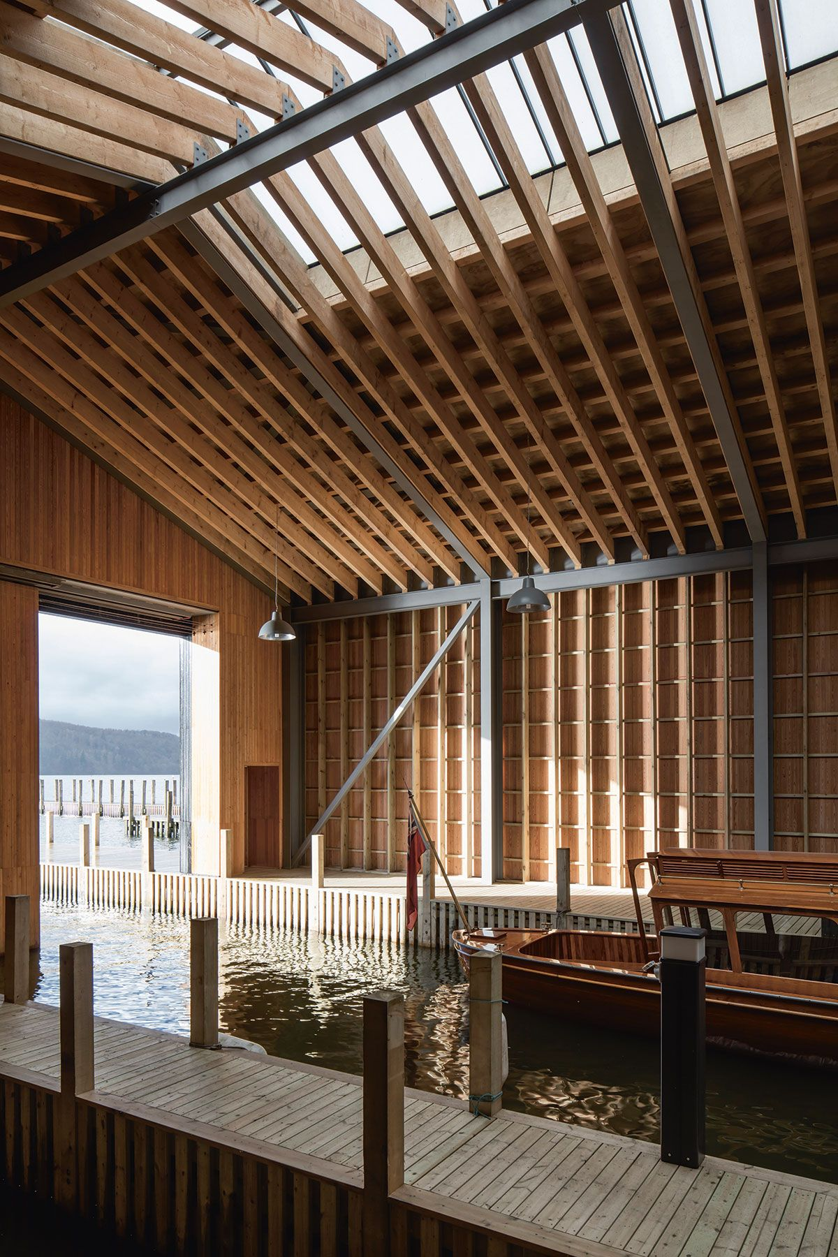 It was almost inevitable a boathouse would be central to the design the large sliding